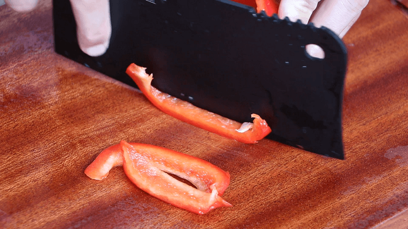 Chop Half Red Bell Pepper To Beautify Sauce