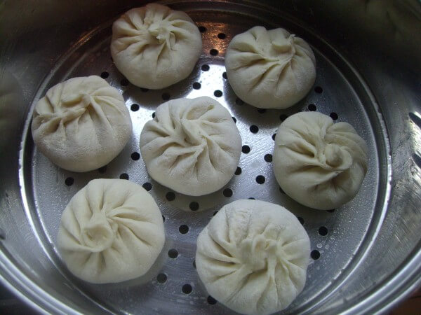 Place the wrapped buns on a drawer of oil.