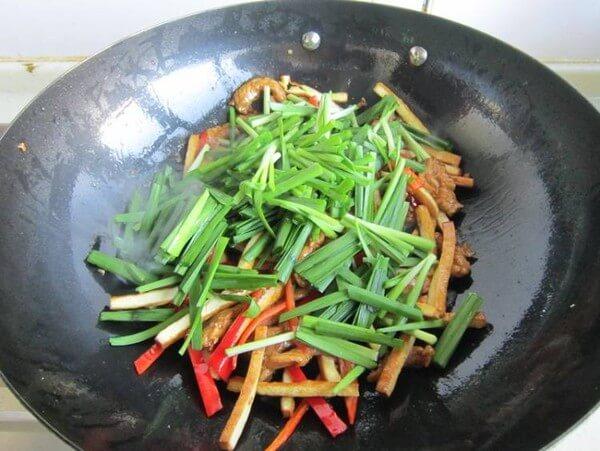 Add light soy sauce to stir-fry