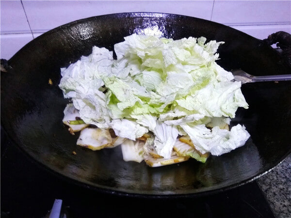 Add cabbage leaves and continue to stir fry;