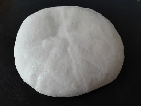 Cover and wrap the whole cake with the remaining large piece of dough