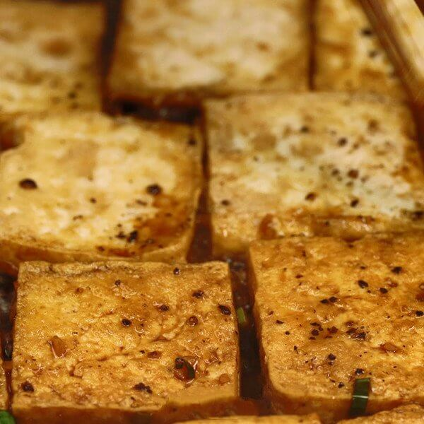 Remove excess oil from the pan, add sauce and tofu