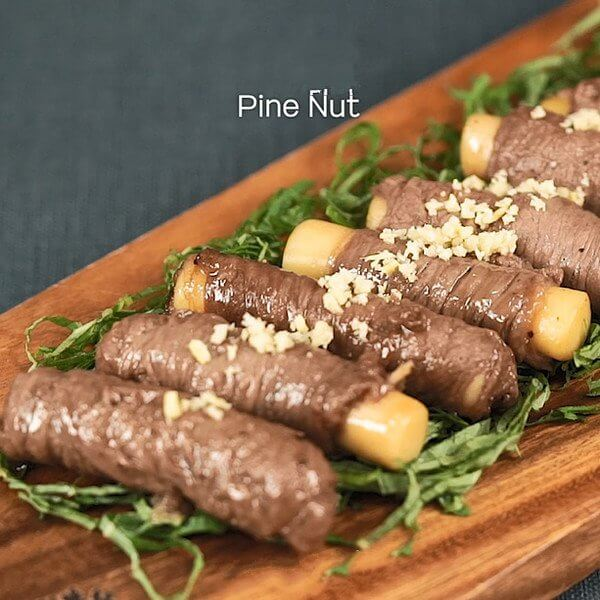Sprinkle with crushed pine nuts to finish