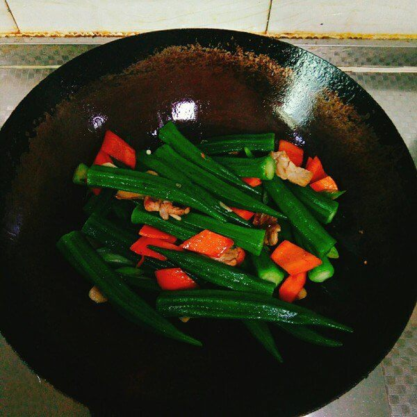 Add okra, salt, soy sauce and cook.