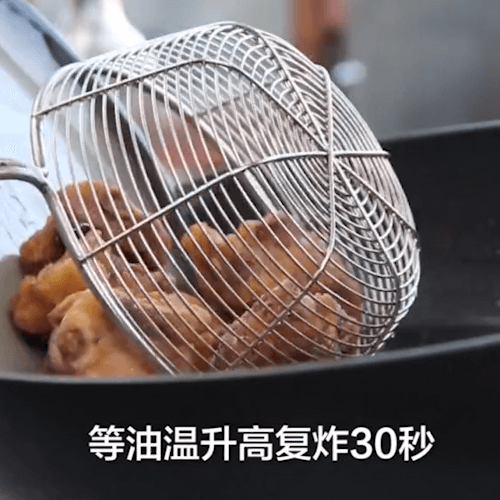 After the oil temperature rises, fry and fry until brown