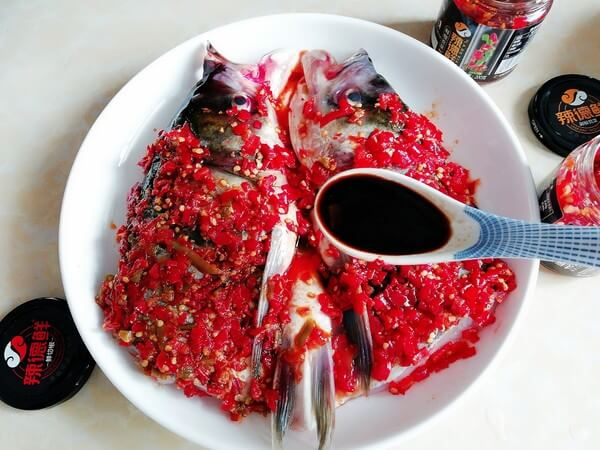 Pour in steamed fish sauce.