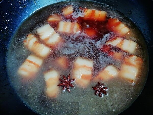 Add the star anise and the remaining ginger slices,