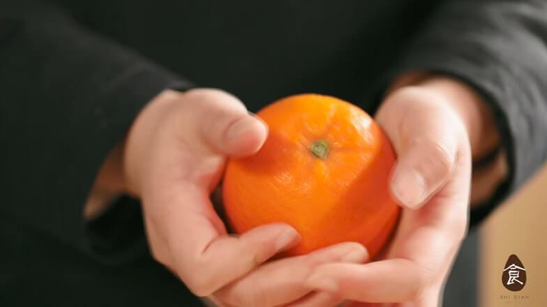 Pinch the orange