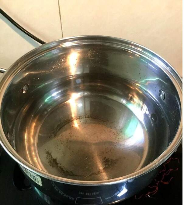 Add more water into the soup pot