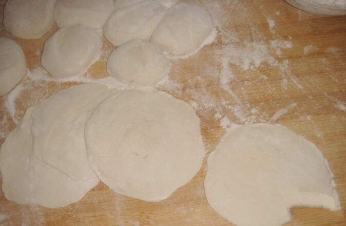 The loose dough is twisted into long strips
